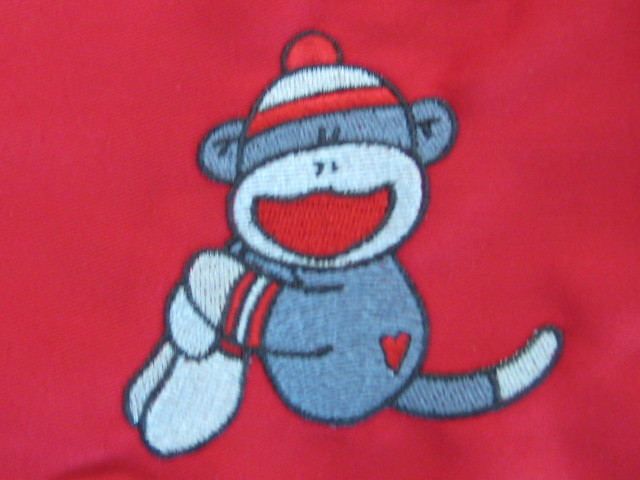 Sock monkey on red apron