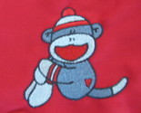 Sock monkey on red apron thumb155 crop