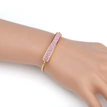 UNITED ELEGANCE Gold Tone Bolo Bar Bracelet With Pink Swarovski Style Cr... - $22.99