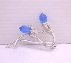 Sapphire Glass Bud Rhodium Plated Stem Embedded CZ Brooch Pin - $14.03