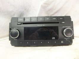 07-10 Chrysler Dodge Jeep Sirius RES Radio Cd Face Plate P68021157AD DEL16 - $17.08