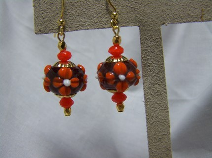 Amethyst orange lampwork glass floral dangle earrings
