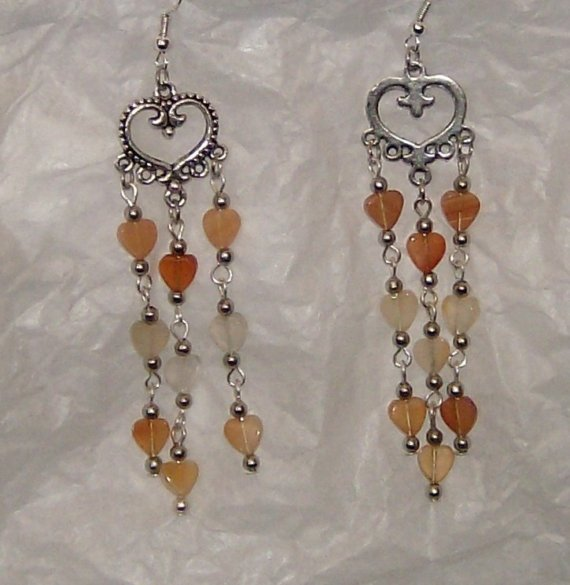"Amber, peach and clear hearts in silver earrings apx 3"" dang"