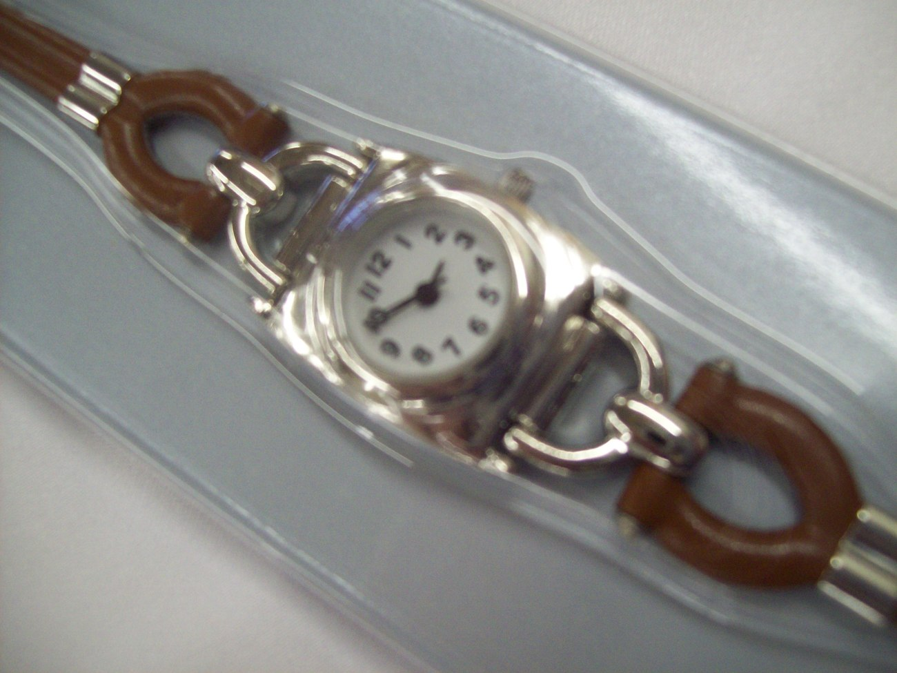 Primary image for AVON Wrist Watch with Equestrian Style Band NIB Brown and Silver Chrome in Color
