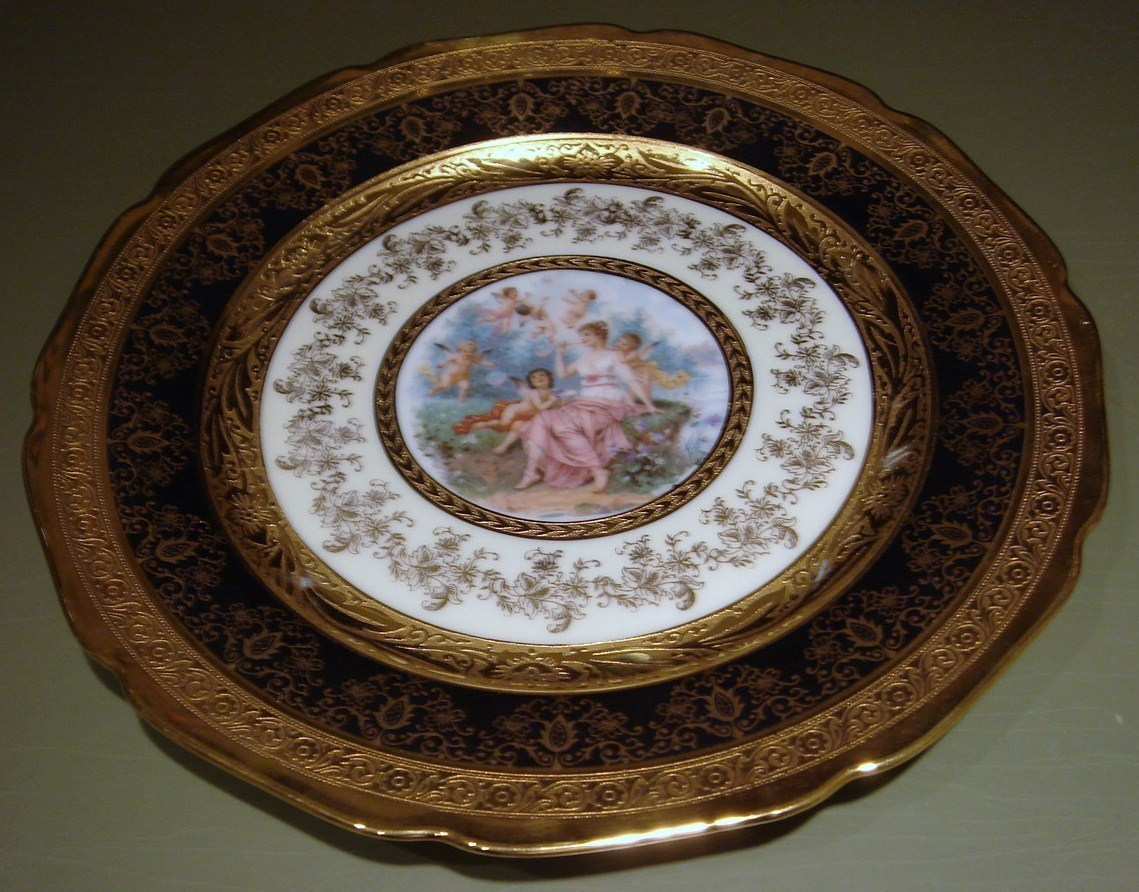 Plate  bohemia gold with central figure 1