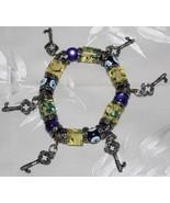 Purple Evil Eye,Gold Floral Bead Stretch Bracelet - $14.95