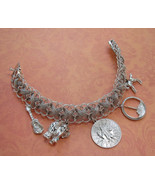 Sterling silver woven charm bracelet with five charms. - $60.00