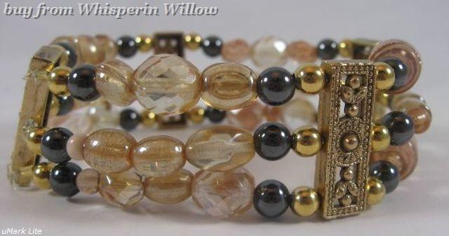 Champagne and hematite goldtone bracelet 1