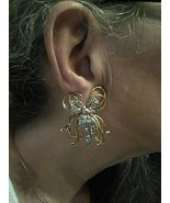 VINTAGE CLIP BUTTON EARRINGS GOLDEN BOW TOPPED WITH PAVE SILVERTONE BOW - $30.00