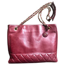 Vintage CHANEL wine leather tote bag with gold chain handles and CC moti... - $1,352.00