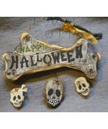 Small Skulls and bones Happy Halloween Primitive Sign Ornament  - $4.99