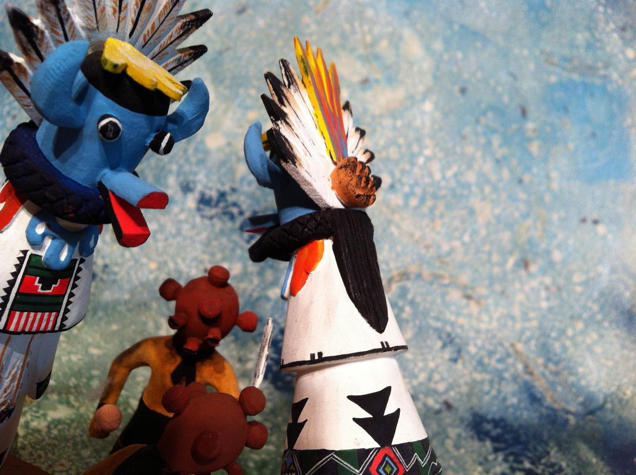 Miniature Mudhead and Shalako Kachina dolls in a Dance