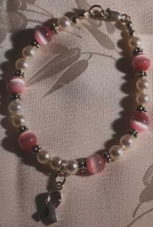 Pink cats eye   pearl bracelet w bc ribbon