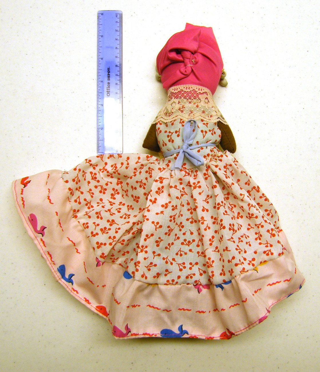 Brown cloth doll with basket