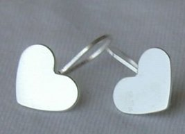 Mini silver hearts earrings - $10.00