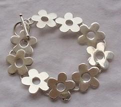 Silver flowers bracelet  - $75.00