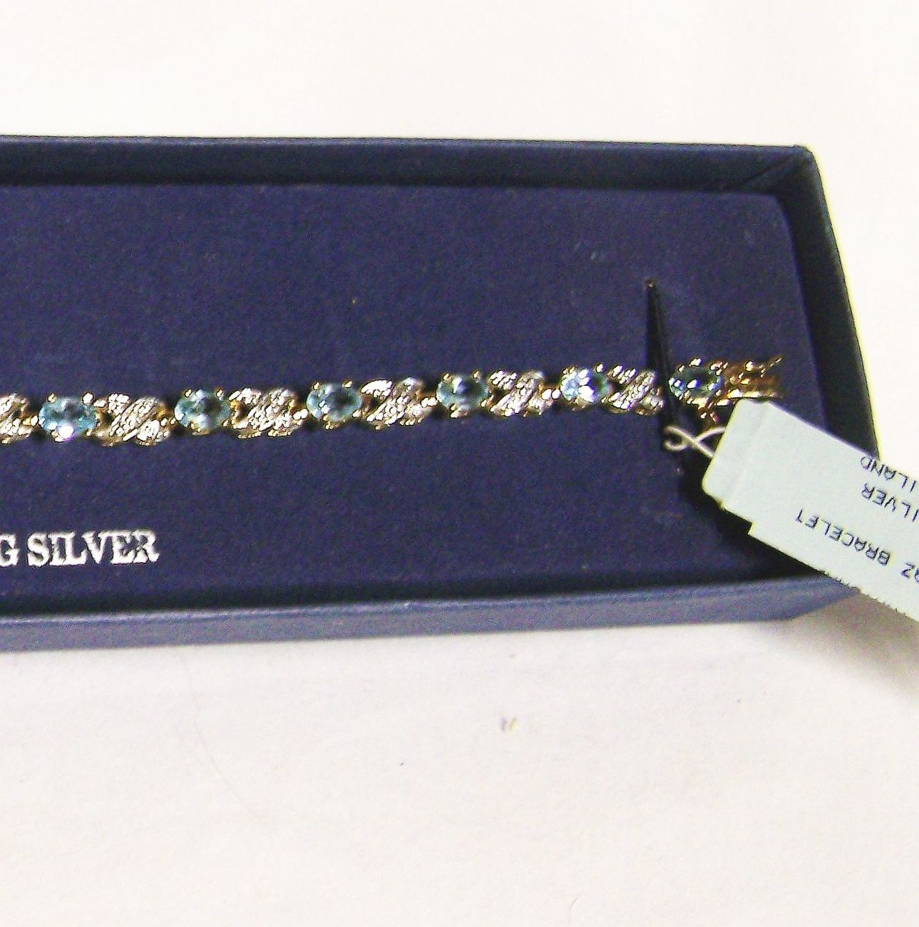 NEW GOLD OVER STERLING SILVER & BLUE TOPAZ TENNIS BRACELET, 7-1/4 INCH