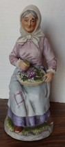 Homco-Old woman holding baskets of grapes-#1433-8 inches tall - $14.96