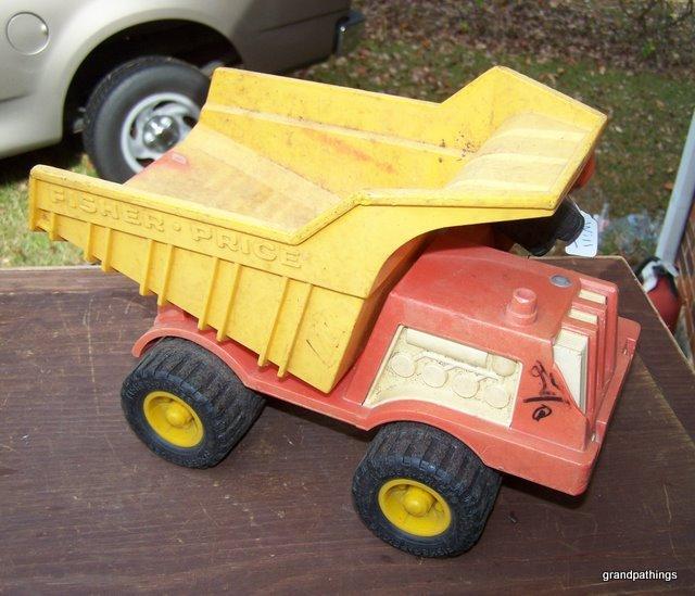 "Vintage Fisher-Price Plastic Dump Truck #302 12"" Long."