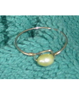 Yellow pearlized stone and goldtone twisted wire ring - $8.00