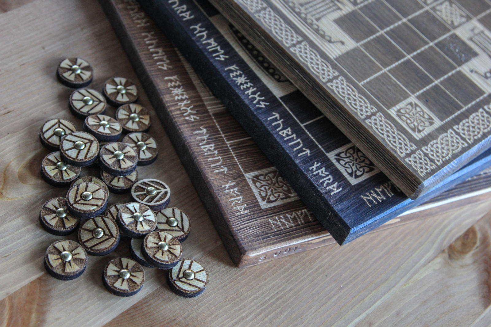 Tablut Hnefatafl game decorated with runes inspired by Vikings Show