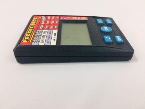 Radica Pocket Electronic Handheld Vegas Slot Machine LCD Game Model 1370