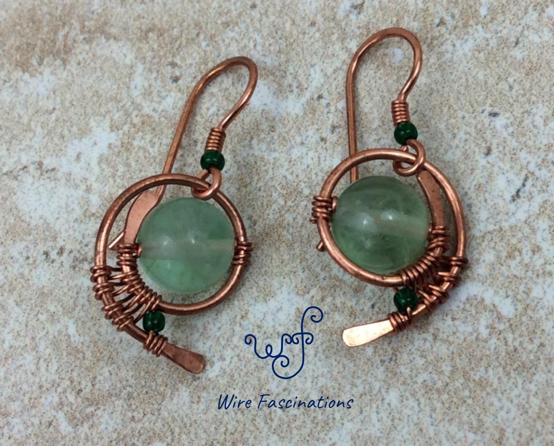 Handmade green fluorite earrings wire wrapped copper swirl main