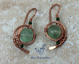 Handmade green fluorite earrings: copper wire wrapped swirl - $28.00