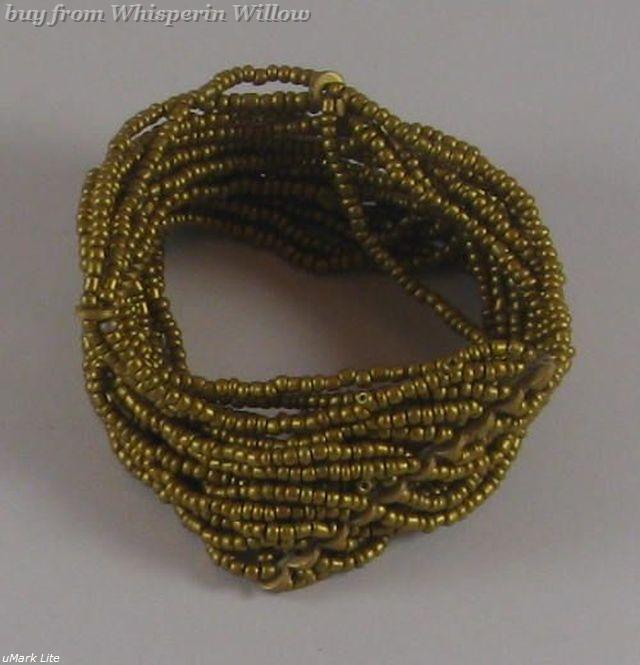 20 strand gold glass bead stretch 1