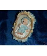 """Baby Boy in basinet 3""""tall x 3.5""""long favor in blue - $2.00"""