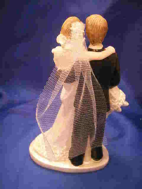 """poly resin groom carries the bride 6"""" tall cake top"""