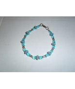 7 and 1/2 inch handmade blue and silver beaded bracelet - $7.50