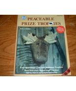 Peaceable Prize Trophies  Sewing Sportsman Sculptures - $5.00