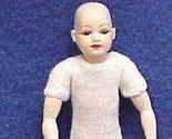 Child undr brown bald head thumb155 crop