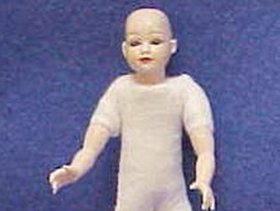 Child undr blue bald head