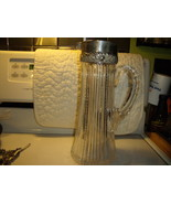 Sterling Repousse and Crystal Pitcher - $435.00