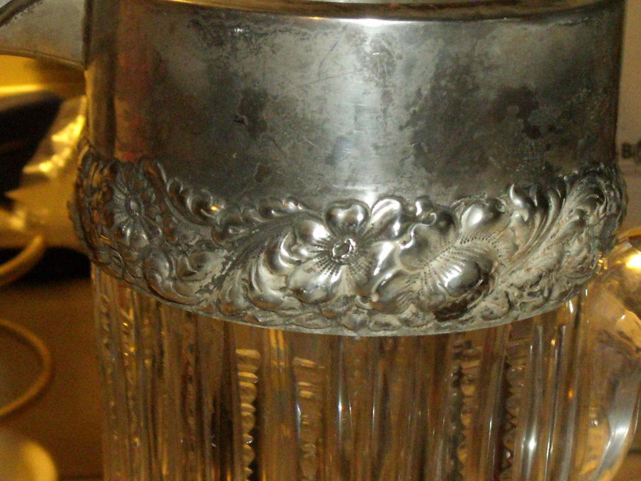 Sterling Repousse and Crystal Pitcher