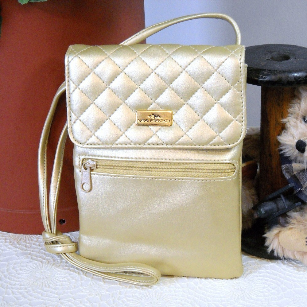 Retro handbag via piaggi small gold quilted