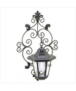 Four solar panels on top of scrolled hurricane wall lantern - $21.88