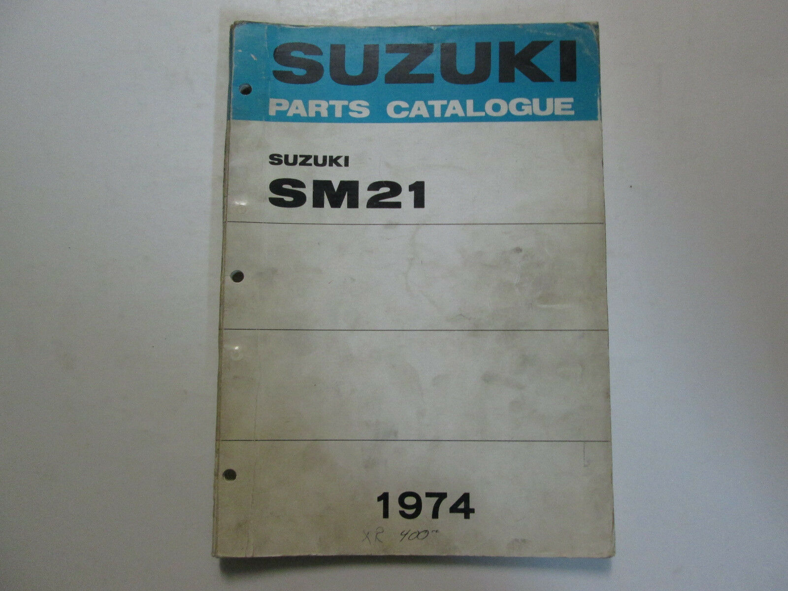 Primary image for 1974 Suzuki Snowmobile SM21 K/L Parts Catalog Manual STAINED WORN FACTORY OEM
