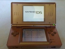 Nintendo DS Lite Metallic Rose Gold Pink Coral w/ Stylus Comes With Charger - $46.74