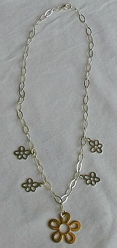 Golden flowers silver necklace