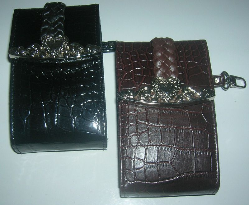 2 CELL PHONE CASES  FOR BLACKBERRY/CAMERA/CIGARETTES