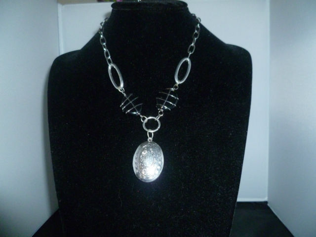 Fantastic Art Necklace with Locket. Silvered will hold a precious picture.