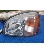 2000 DEVILLE LEFT HEADLIGHT OEM USED ORIGINAL CADILLAC GM PART NUMBER 20... - $122.02