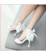92H004 Lady's Extra large 16 cm heel booties, size 9.5-11, white - $52.80