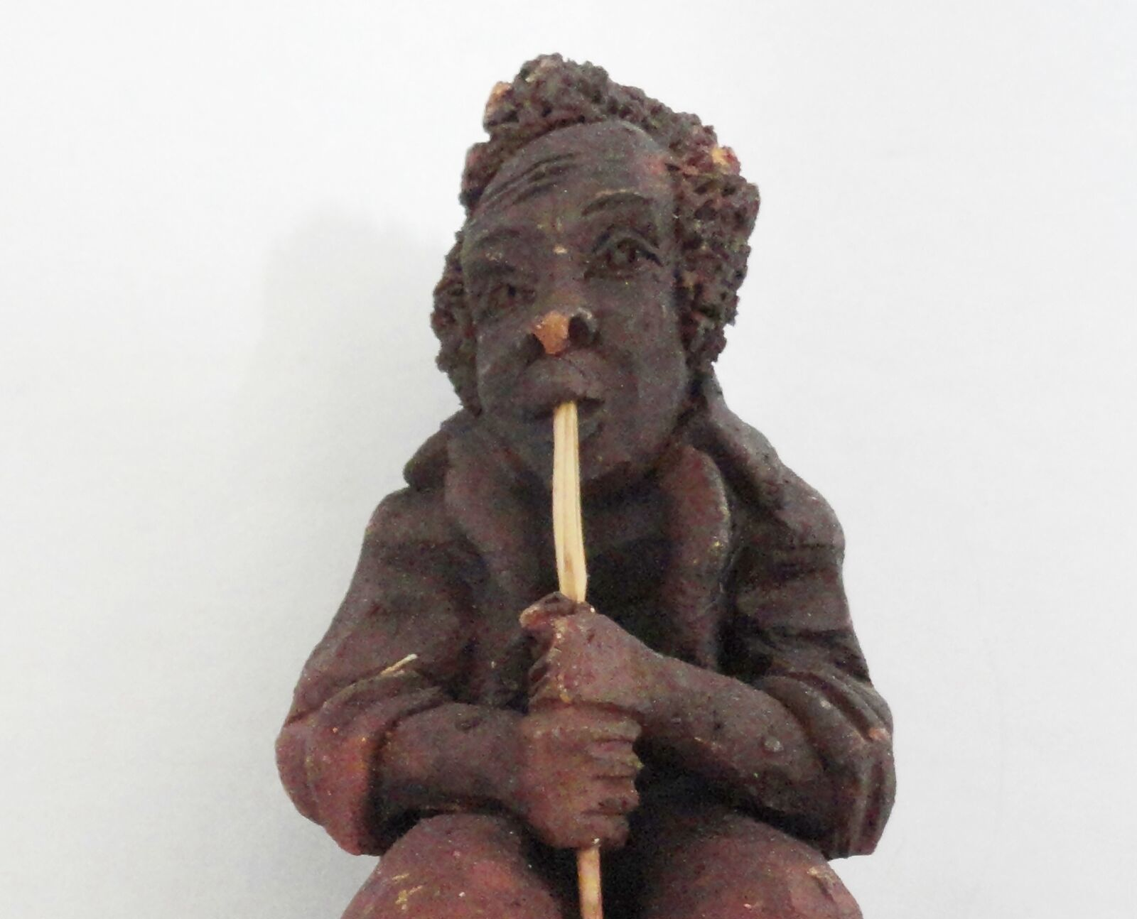 Musician Red Clay Figurine Playing a Wind Instrument