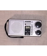AM/FM Radio with LCD Alarm Clock Model No. 845 Pocket Handheld by LIFELONG - $11.26
