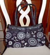 Thirty One Black handbag wearing a black and white skirt  - $13.00