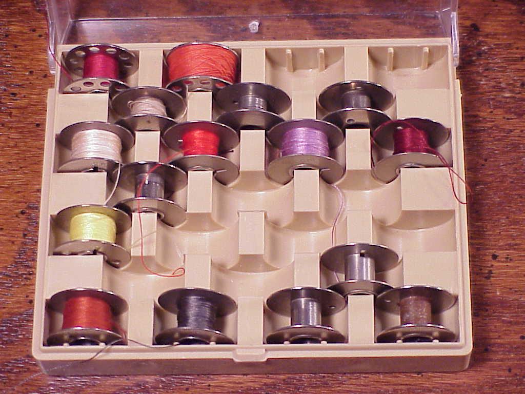 2 Cases of Metal Bobbins, 34 Bobbins, Necci Boxes